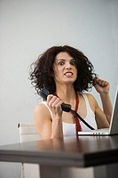 Frustrated businesswoman using a laptop