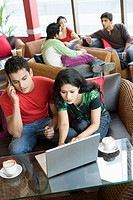 Couple shopping online in cafe