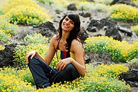 Woman, young, smiles, tailor-seat, flower-meadow, rocks,