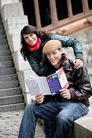 France, Paris, pair, young, smiles, guides, map, look at,