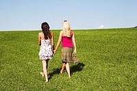 Teenagers, girls, barefoot, walk, meadow, hand in hand, back-opinion, series, people, 18-19 years, friends, long-haired, hair-color deceased, hands ho...