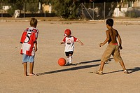 Gives birth, ages, skin color, differently, soccer games, runs, stands, people, children, toddler, 2-3 years, 7-10 years, red, ball, plays, football, ...