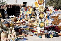 Tunisia, Djerba, Midoune, businesses, sale, earthenware, outside, buildings, souvenir-businesses, souvenir-sale, souvenirs, earthenware, dishes, potte...