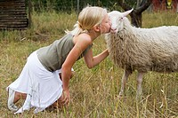 Girl kissing her ewe