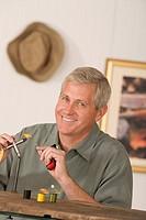 Man threading a fishing lure