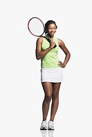 Young adult woman posing with tennis racquet