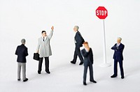 Businessmen figurines and a stop sign
