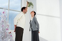 Couple standing under a mistletoe
