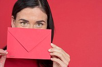 Woman holding a red envelope