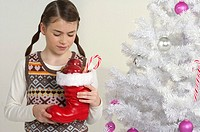 Girl holding a Santa Claus boot