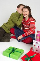 Boy whispering in girl's ear