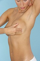 Young naked woman Touching, Cancer, Breast Cancer, Prevention, Surgery her chest part of, close-up