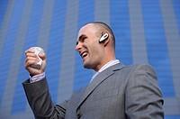 Businessman with headset crushing a beaker