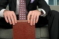 Businessman holding his diary