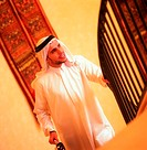 Arab businessman walking up stairs (thumbnail)