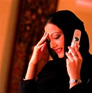 Arab woman using a cell phone