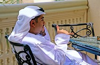 Arab man speaking on the phone