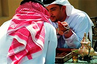 Arab men enjoying tea and a game of backgammon