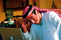 Arab businessman using a laptop