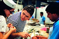Western tourists on the fish market in Dubai, United Arab Emirates
