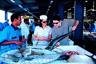 Western tourists on the fish market in Dubai, UAE