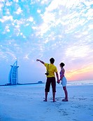Western couple on the beach near Burj Al Arab, Dubai, UAE