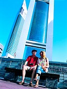 Western couple in front of Emirates Towers in Dubai, UAE