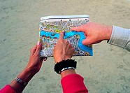 Tourists looking at a map of Dubai, UAE