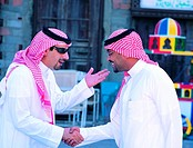 Saudi men greeting each other in Old Town of Jeddah, Saudi Arabia