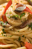Spaghetti with anchovies and peppers close-up (thumbnail)