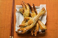 Deep-fried chicken feet on paper Asia