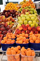 Fruit stall with apricots, peaches, apples, oranges