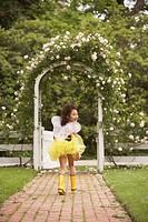 Young Hispanic girl wearing bumble bee costume