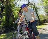 Senior Hispanic couple riding bicycles