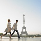 Couple walking with Eiffel Tower in background (thumbnail)