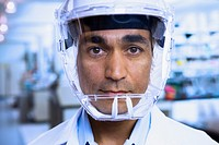 Close up of Indian male scientist wearing respirator