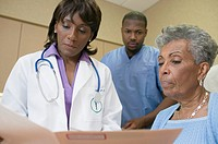 African female doctor with co-workers
