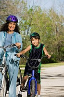 Hispanic mother and son riding bicycles