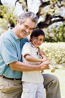 Father and son holding baseball bat