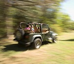 Blurred motion shot of people in jeep