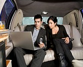 Hispanic businesspeople working in limousine