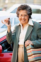 Senior Hispanic woman holding car keys