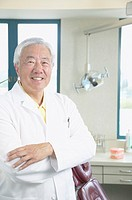 Senior Asian male dentist smiling
