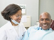 African female dentist with male patient