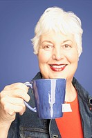 Studio shot of senior woman with tea