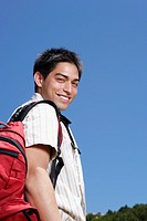 Hispanic man wearing backpack outdoors