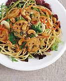 Spaghetti with shrimps, broccoli and cashew kernels