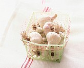 Garlic in small plastic basket