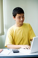 Close-up of a boy using a laptop