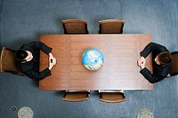 High angle view of two businessmen sitting at a conference table